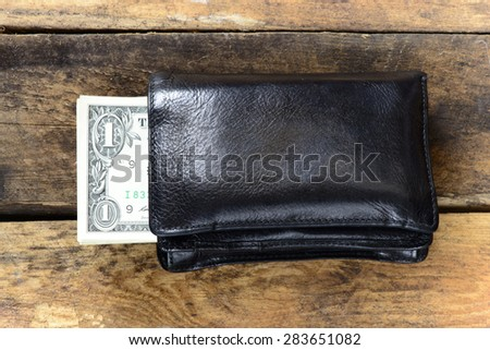 Wallet with one dollar banknote - stock photo