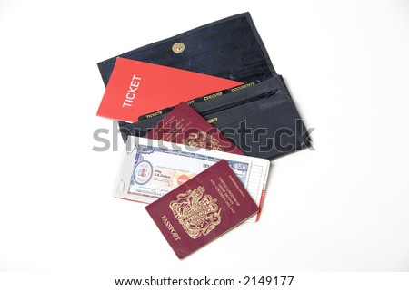 Wallet with passports, tickets and travellers checks - stock photo