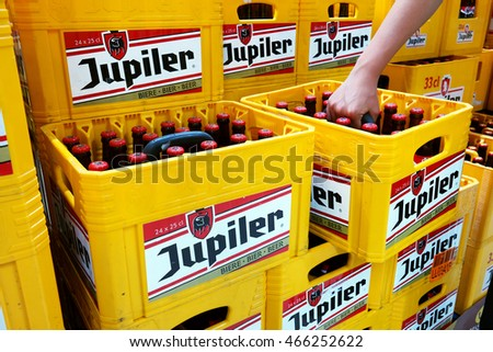 WALLONIA, BELGIUM - MAY 4, 2016: Stack of Jupiler pilsener beer crates in a Carrefour Hypermarket. Jupiler is a Belgian beer brewed by InBev at Piedboeuf Brewery is the biggest-selling beer in Belgium