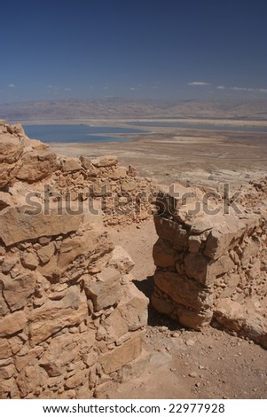 Walls from the Masada ruins and the Dead Sea - stock photo