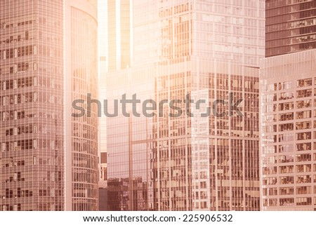 Walls of the buildings in the business city center at sunrise time. - stock photo