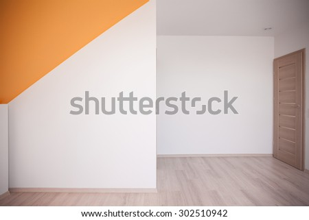 Walls painted white with orange color accent on the ceiling - stock photo