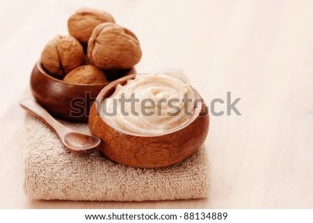 walnut body scrub with towel - beauty treatment - stock photo