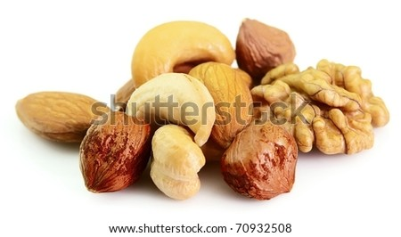 Walnut, filbert, cashew and almonds on a white background