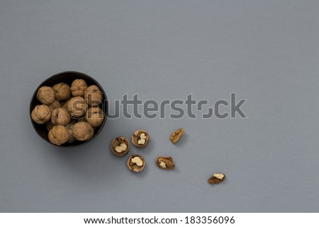 Walnut in Bowl on Gray background