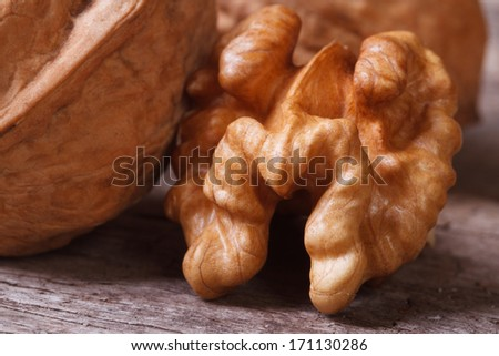 Walnut kernel macro on a wooden table old - stock photo