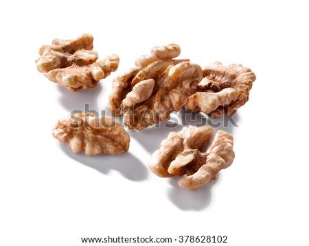 walnut kernels macro  isolated on white background - stock photo