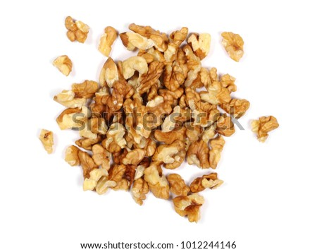 Walnut kernels, pile isolated on white background, top view