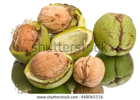 Walnuts and green shell isolated on white background