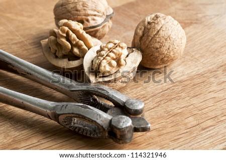 Walnuts and nut cracker - stock photo