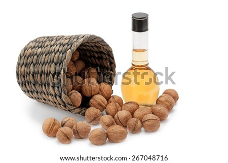 walnuts and oils isolated on white background - stock photo