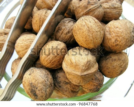 Walnuts in a bowl with a nutcracker
