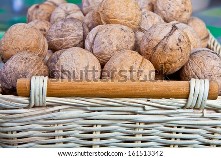 walnuts in a wicker basket close-up  - stock photo