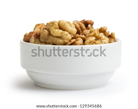 walnuts in bowl, isolated on white background - stock photo
