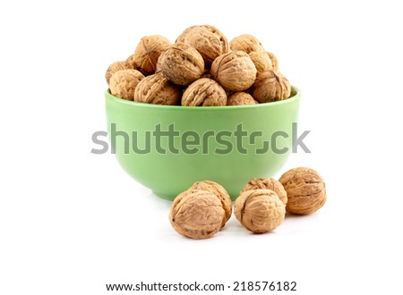 walnuts in dish on a white background - stock photo