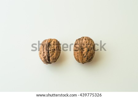 Walnuts in shell on a white background - stock photo