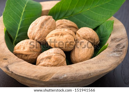 Walnuts in shells on the table