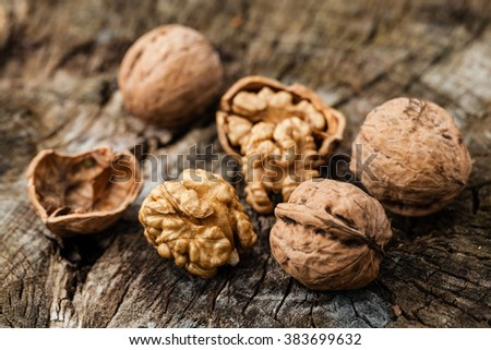 walnuts isolated on a wooden table - stock photo