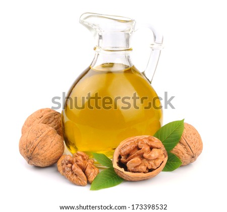Walnuts oil and walnuts isolated on white background