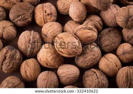 Walnuts whole in their skins, chopped, nut hulls, walnut kernels - stock photo
