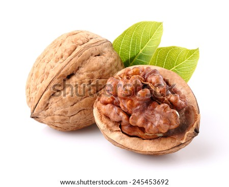 Walnuts with leaf in closeup - stock photo