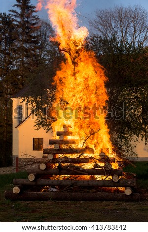 walpurgis night, religion christian festival, burning fire wood, traditional burning witches on stake with huge flames - stock photo