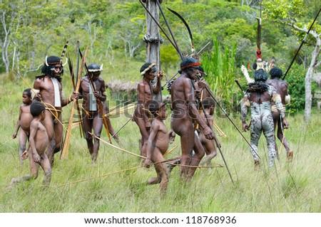 WAMENA, PAPUA, INDONESIA - NOVEMBER 14: People of Dani tribe performing traditional fighting dance on November, 14, 2008 near Wamena, Papua, Indonesia. - stock photo