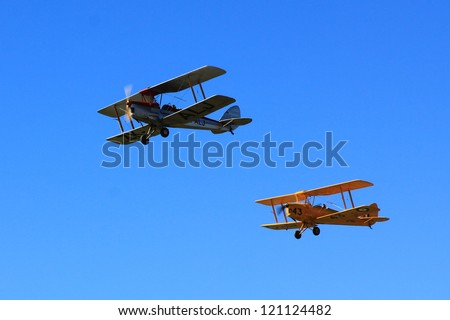 """WANAKA MARCH 03: Bristol F.2B and Tiger Moth D-2  vintage air-crafts fly during the royal New Zealand air force 75th anniversary""""Warbirds Over Wanaka"""" airshow on March 03, 2012 in Wanaka New Zealand - stock photo"""