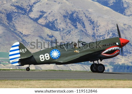 "WANAKA-MARCH 03:Curtiss P-40 Kittyhawk aircraft on the runway during the royal New Zealand air force 75th anniversary  ""Warbirds Over Wanaka"" airshow on March 03, 2012 in Wanaka New Zealand"
