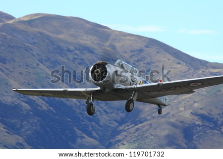 """WANAKA MARCH 03: Grumman avenger aircraft flies over the mountains during the royal New Zealand air force 75th anniversary""""Warbirds Over Wanaka"""" airshow on March 03, 2012 in Wanaka New Zealand - stock photo"""