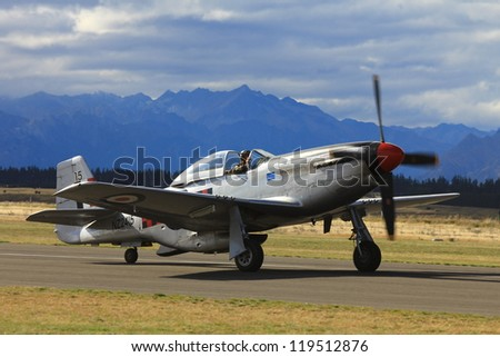 """WANAKA-MARCH 03: P-51D Mustang aircraft on the runway during the royal New Zealand air force 75th anniversary """"Warbirds Over Wanaka"""" airshow on March 03, 2012 in Wanaka New Zealand - stock photo"""
