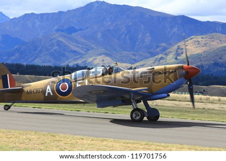 """WANAKA MARCH 03: Supermarine Spitfires aircraft on the runway during the royal New Zealand air force 75th anniversary""""Warbirds Over Wanaka"""" airshow on March 03, 2012 in Wanaka New Zealand - stock photo"""