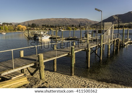 WANAKA, NEW ZEALAND - JAN 7, 2016: The historic Lake Wanaka district is one of the country's most popular visitor destinations.  The area features lakes, ski fields and dramatic mountains. - stock photo
