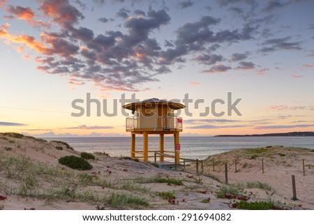 Wanda Beach Lifeguard lookout tower with sunrise skies - stock photo