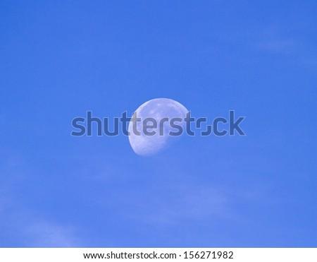 Waning gibbous moon during daytime in September - stock photo