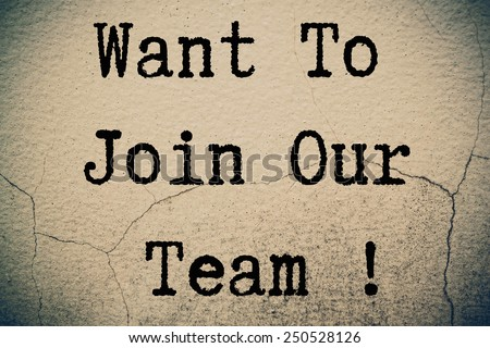 want to join our team ! concept on wall - stock photo