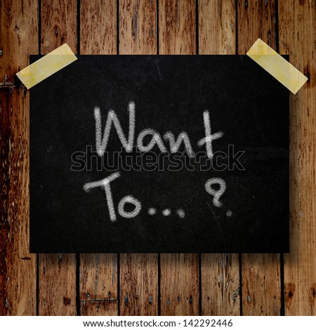 Want to on message note with wooden background - stock photo