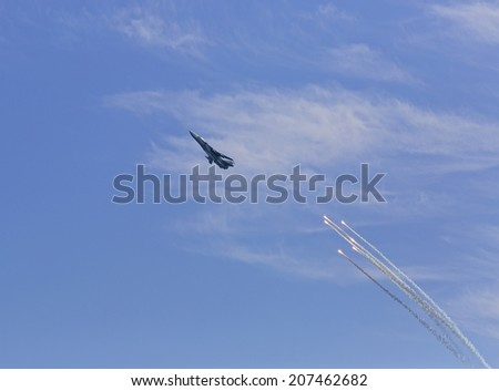 War jet plane in sky. Russian jet fighter launches anti-missile flares during Day of Russian Navy in Sevastopol (Crimea) - stock photo