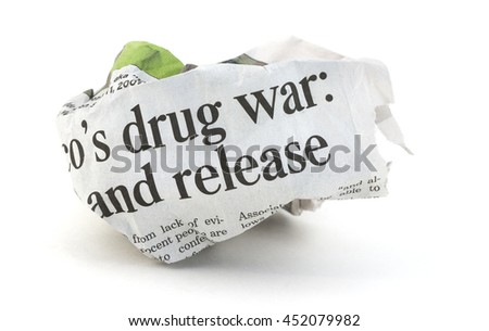 War on drugs newspaper concept on a white background.