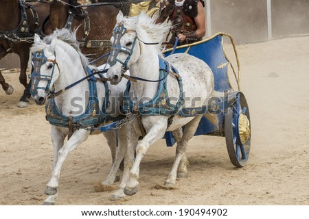 War, Roman chariot in a fight of gladiators, bloody circus - stock photo