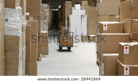 warehouse corridor and handcart, carton stock - stock photo