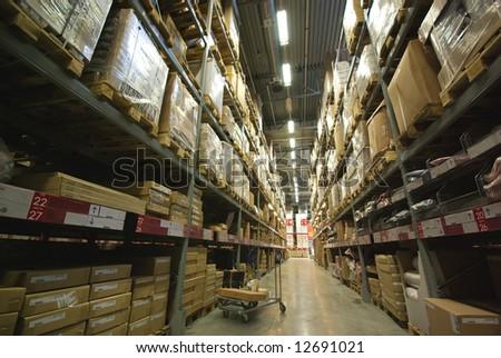 warehouse corridor and handcart perspective - stock photo