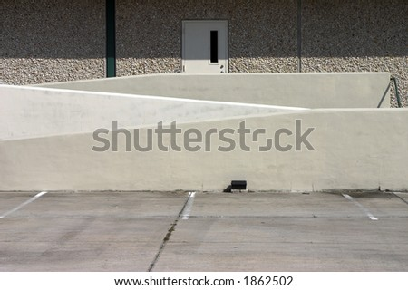 Warehouse door with staircase entry and ramp access - stock photo