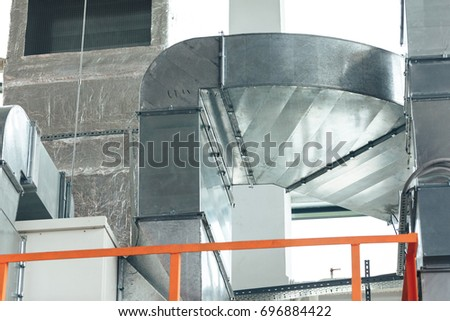 warehouse interior with orange metal constructions for holding industrial crane.