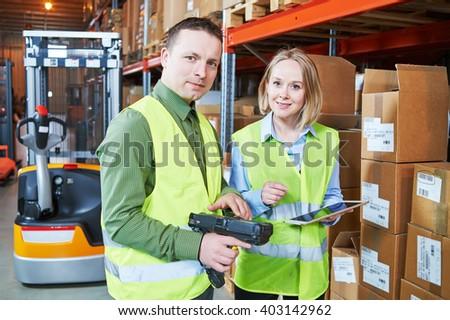 Warehouse Management System. Worker with barcode scanner - stock photo
