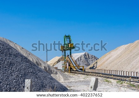warehouse production in quarry blue clay, huge machines for stacking - stock photo