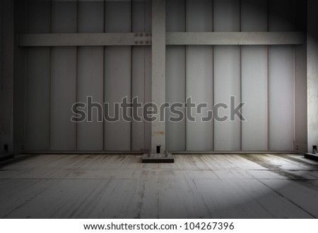 warehouse wall in dim light. - stock photo