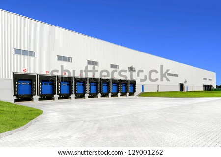 warehouse with blue sky - stock photo