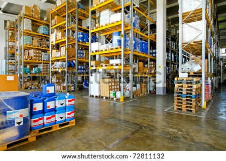 Warehouse with chemical liquids in cans and barrels - stock photo