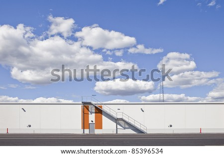 Warehouse with modern architecture on a sunny day - stock photo